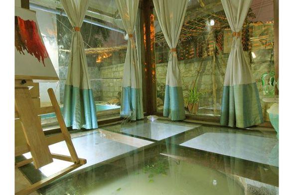 Conservatory / Greenhouse Manasaram Architects
