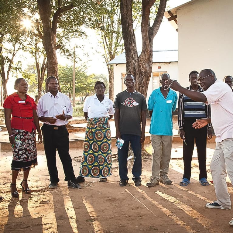 Zambia's Cluster mobiliser, Mathews, leads a group discussion. Photo: Elizabeth Wainwright