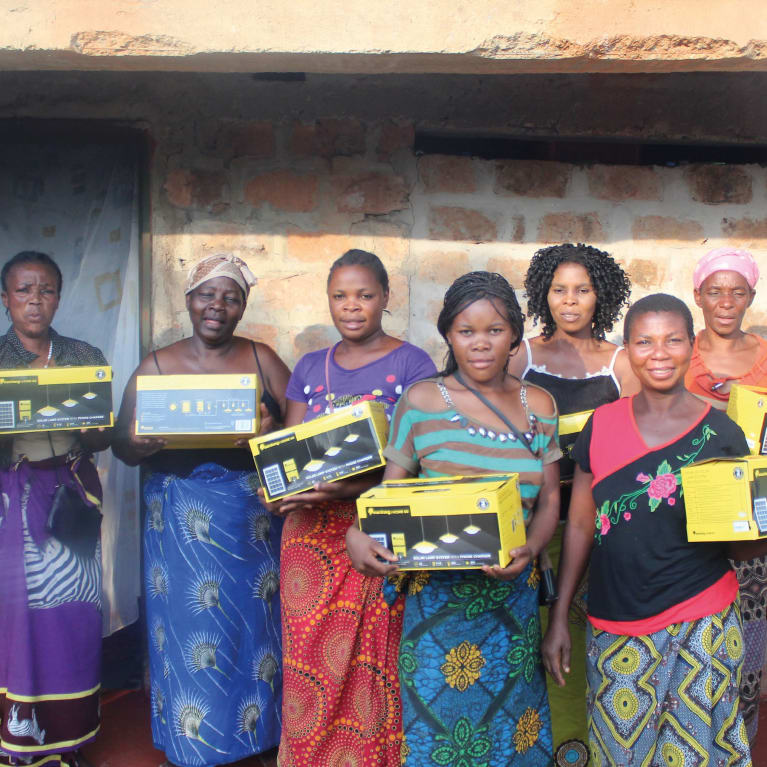 Members of a self-help group with the lights they have been able to buy using a flexible payment plan.