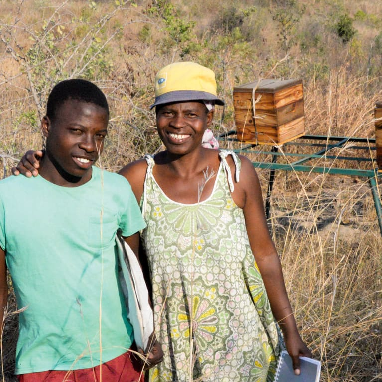 Lonny and her son, Tshegofatso, look after their bees, and the bees look after them.