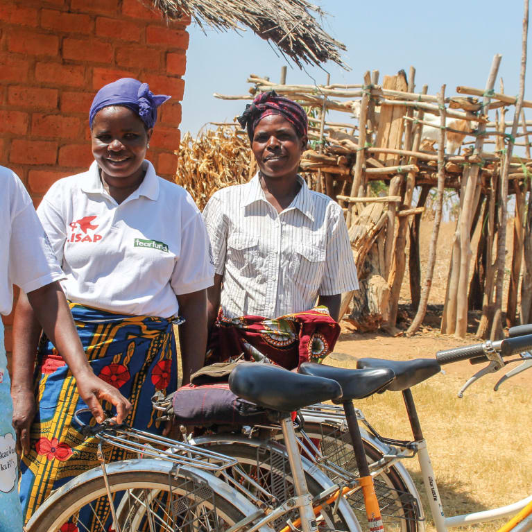 Cynthia, Buseje and Ateefah work as Mother Buddies with Tearfund's partner LISAP in northern Malawi. They help women living with HIV to reduce the risk of passing on the virus to their babies. Photo: Rehema Figueiredo/Tearfund