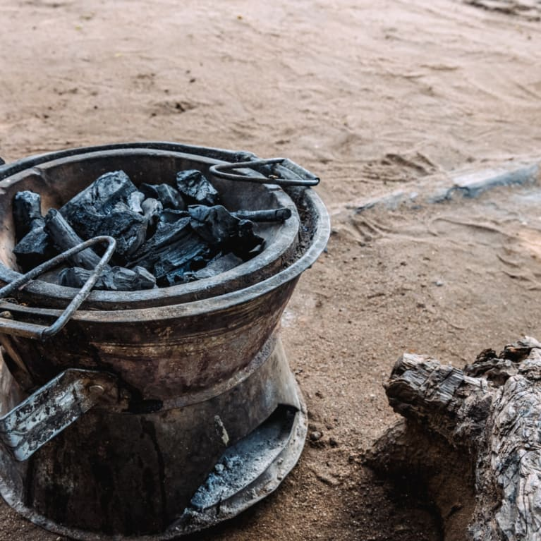 Cooking stove using charcoal briquettes