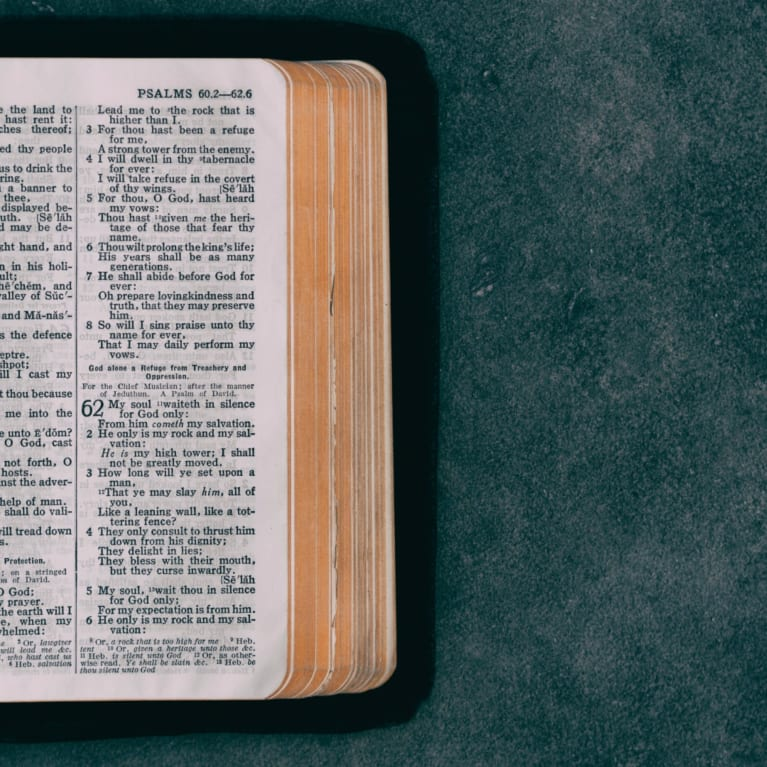 Bible open on table surface