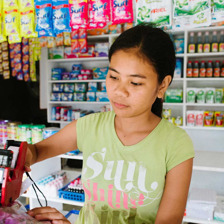 A young person working in a shop. Photo: Tom Price/Integral Alliance