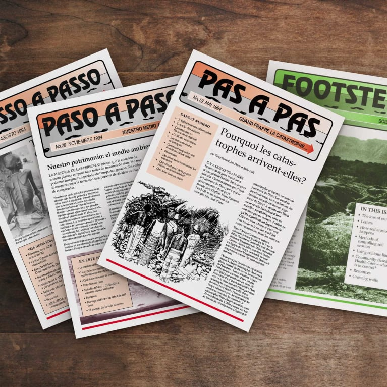 Footsteps magazine issues on a wooden desk.
