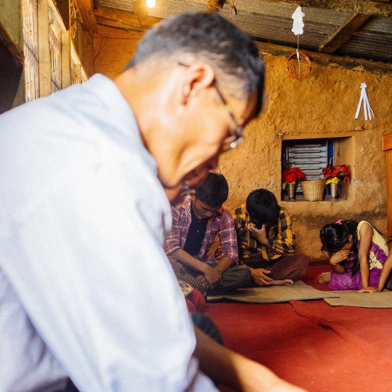 A group praying in Nepal. Photo: Andrew Philip/Tearfund