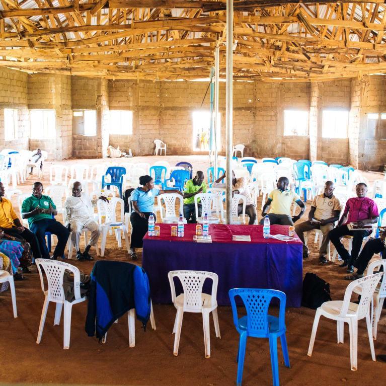 Discussion between community members in Nigeria.