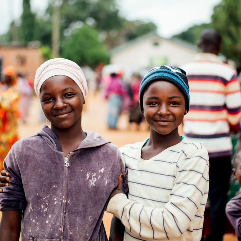 Two girls in an IDP camp in Nigeria, where CRUDAN and other Tearfund partners work. Photo: Ruth Towell/Tearfund