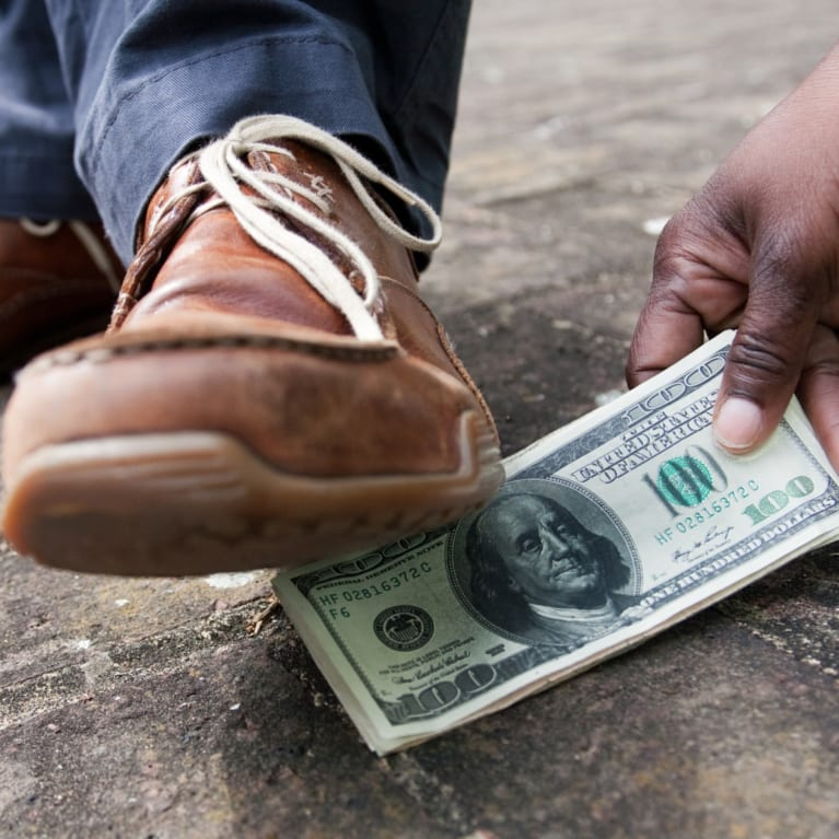 Someone stepping on money, a Zambian euphemism for bribery: Ponya ni pondepo - 'Drop something and I will step on it.'