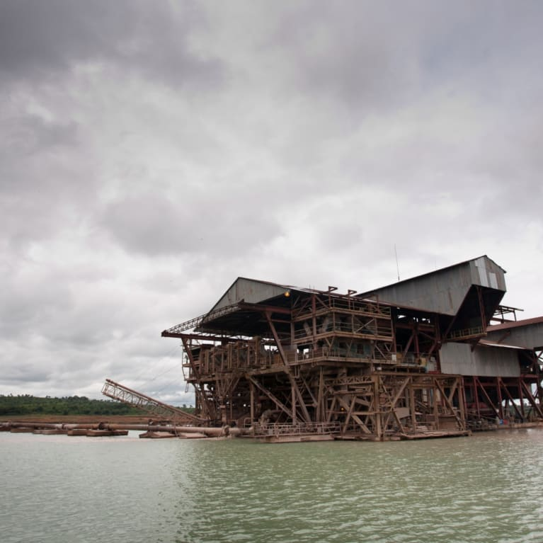 This floating structure, the size of a small office block, is dredging for rutile, the raw material from which titanium is produced. Photo: Jay Butcher/Tearfund