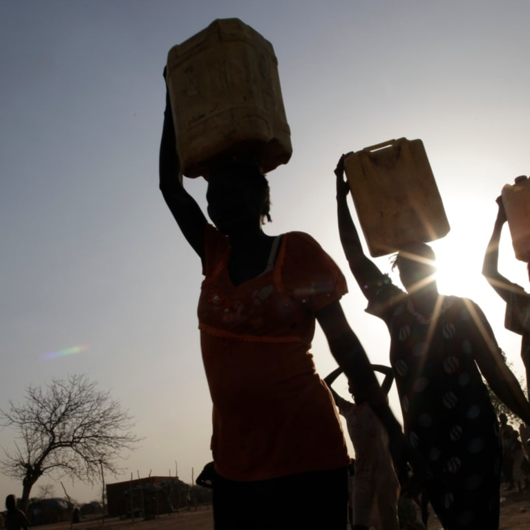 Women from a community in South Sudan return home after collecting water. Photo: Layton Thompson/Tearfund