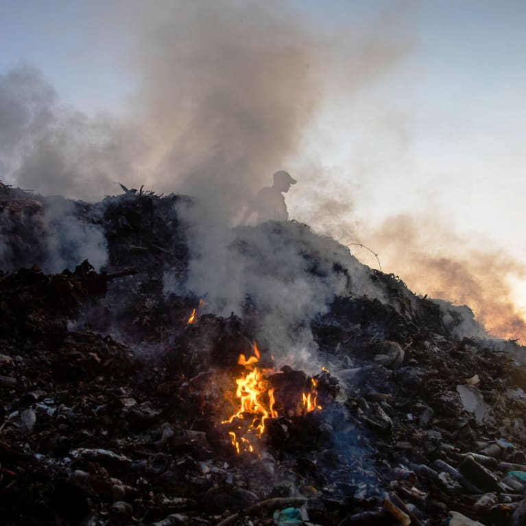 A pile of waste burning in Tanzania.