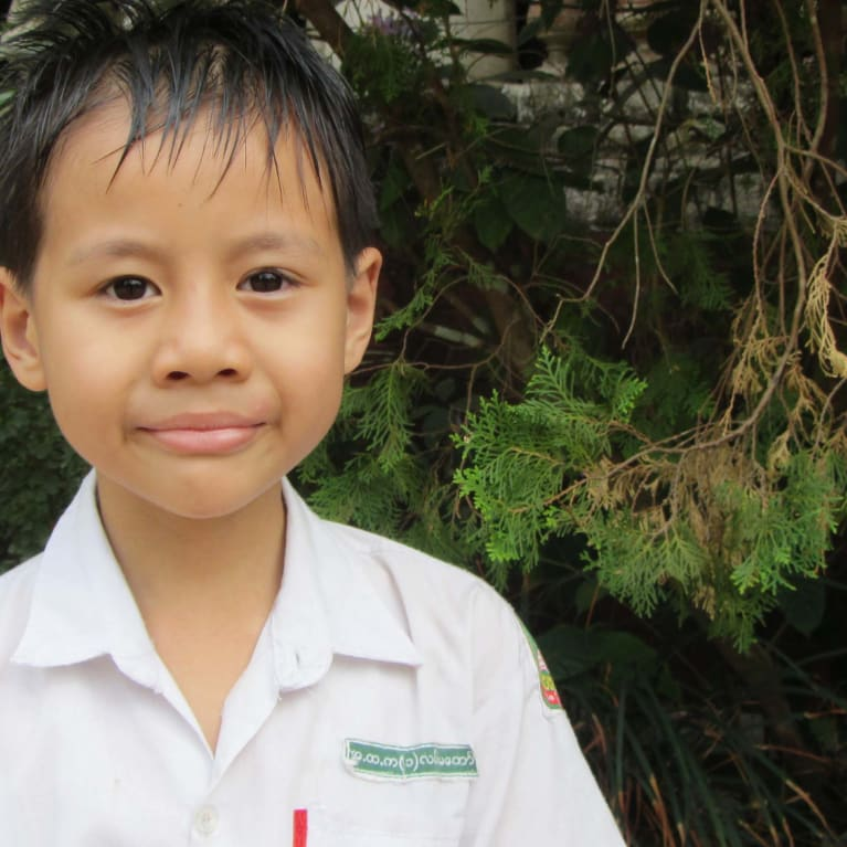 A young boy from Myanmar who could benefit from solar energy for lighting to enable after-school study.