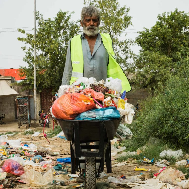 Waste collectors in Pakistan serving their community through a waste management project with Tearfund partner Pak Mission Society (PMS).