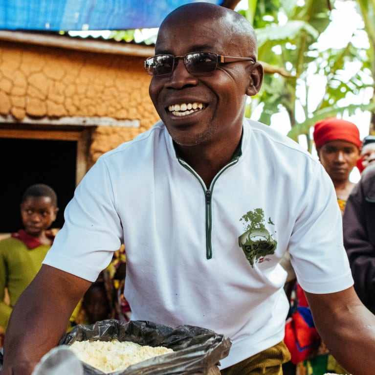 Villagers are shown how to prepare a nutritious porridge to prevent malnutrition. The demonstration is for a food security and nutrition project in Burundi