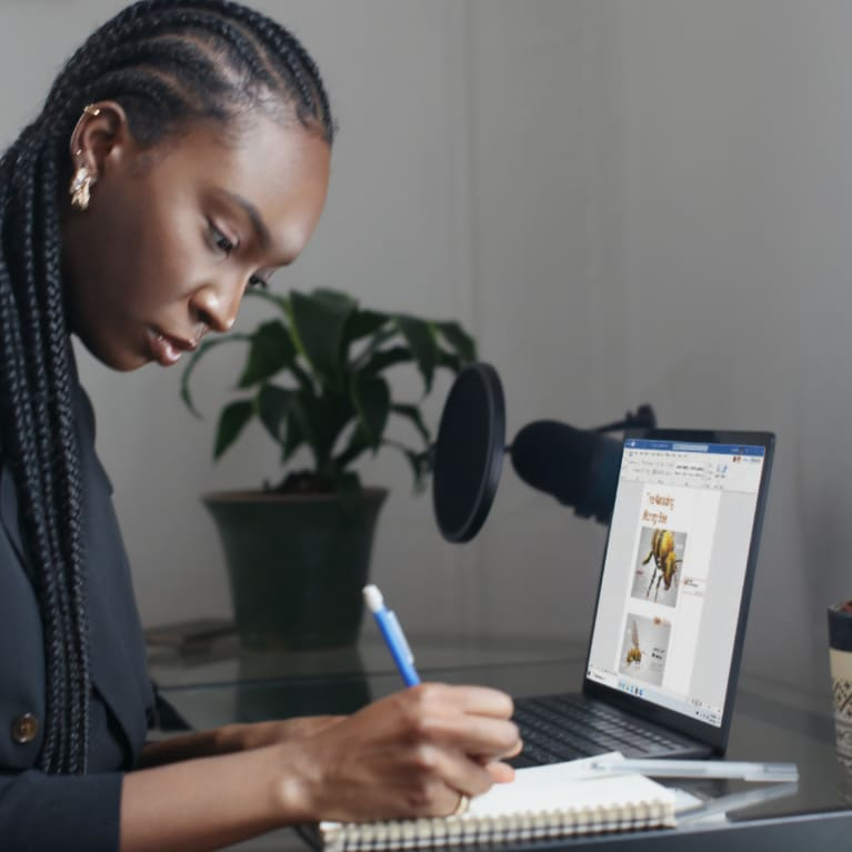 A woman works on her laptop