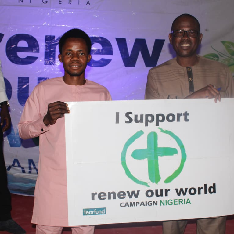 Nigerian campaigners in the city of Jos holding a placard in support of the Renew Our World movement