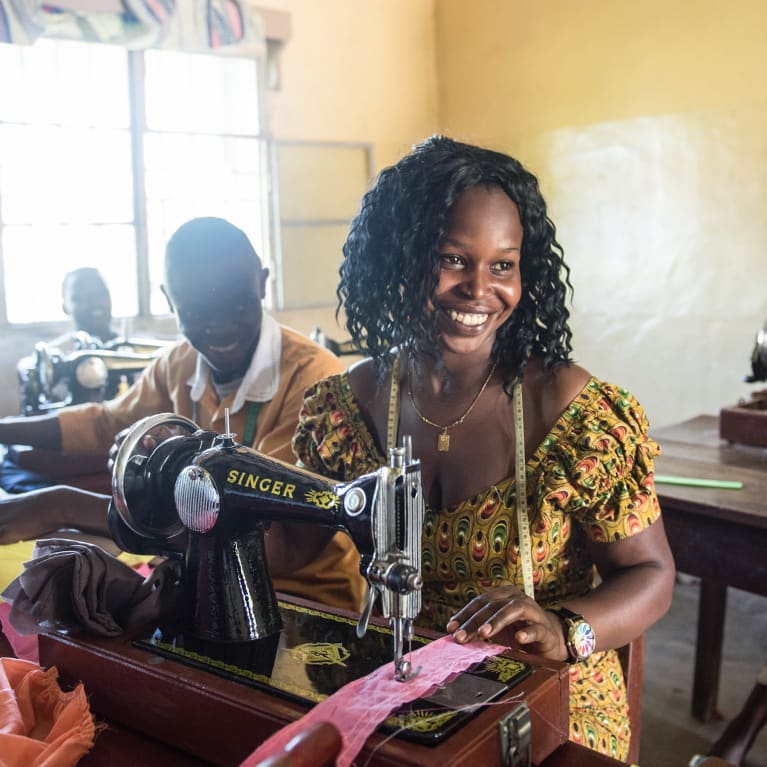 Birungi, from the Democratic Republic of Congo, overcame stigma to become the first woman in her community to set up her own tailoring business | Credit:Hannah Maule-ffinch/Tearfund