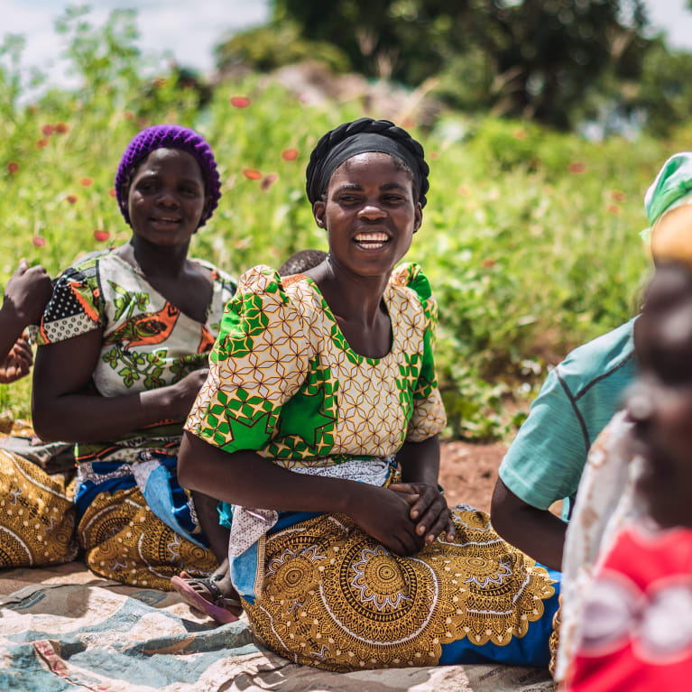 A self-help women's group called Talimbika, which means 'working hard', gathers for prayer and singing in a village in Malawi |Alex Baker/Tearfund