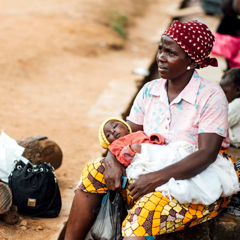 A woman sits with her baby at a camp for internally displaced people in Nigeria   Credit: Ruth Towell/Tearfund
