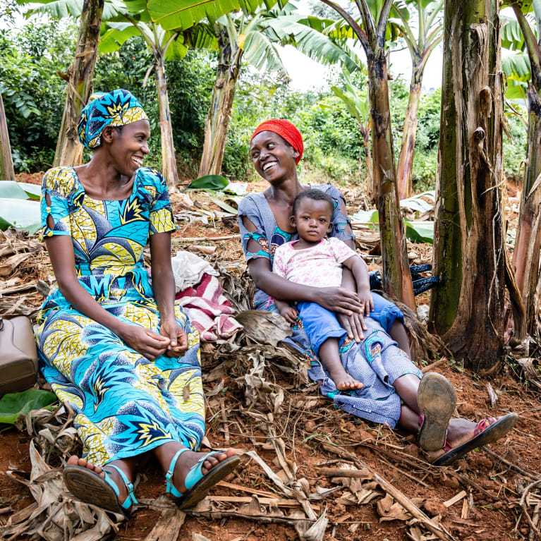 Two women from the Zivu community chat in their banana plantation in southern Rwanda | Credit: Marcus Perkins/Tearfund