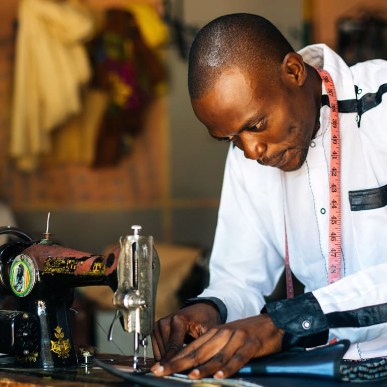 A man working at a sewing machine
