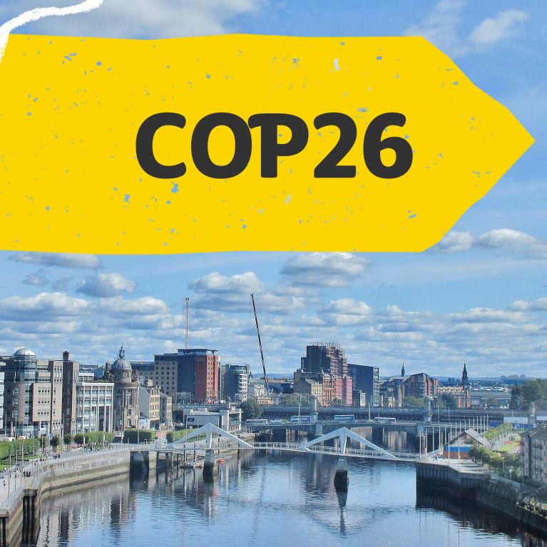 COP26 banner, featuring Glasgow city (Unsplash/Adam Marikar)