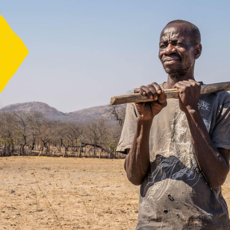 Mtshale Nyoni stands at his now barren farm which he describes as a semi-arid desert (David Mutua/Tearfund)