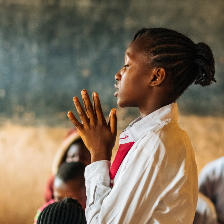 Photo by Tom Price, of a person praying in Nigeria.