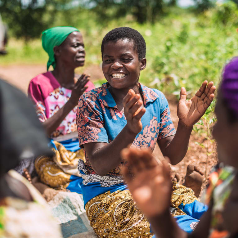 A self-help women's group called Talimbika, which means 'working hard', gathers for prayer and singing in Malawi.Alex Baker/Tearfund