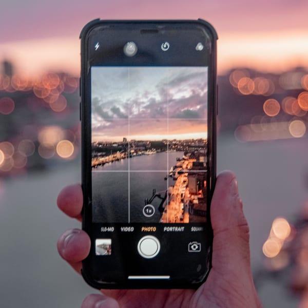 Phone taking photo of landscape.
