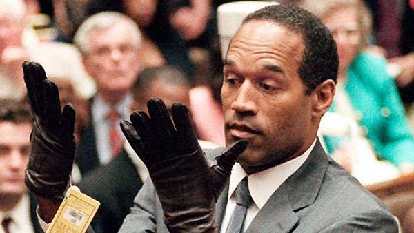 O.J. Simpson putting on the gloves