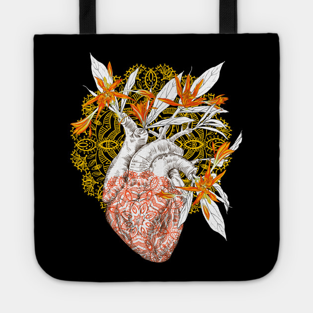 Human anatomical heart with flowers