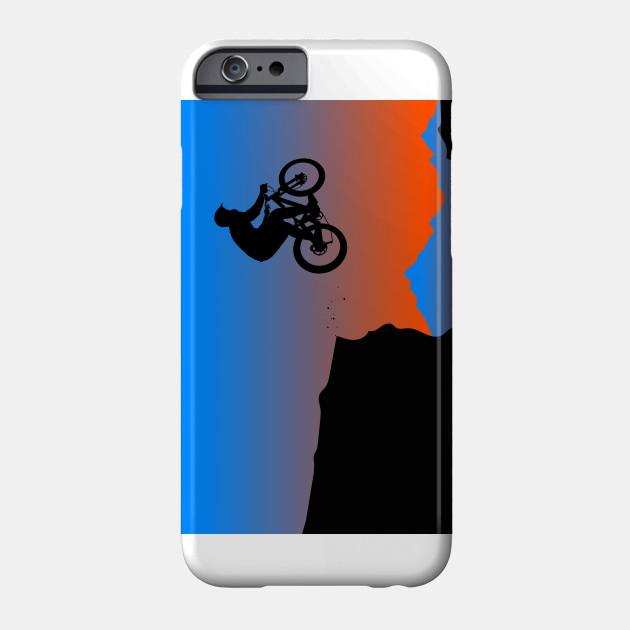 Silhouette of a cyclist riding a mountain bike