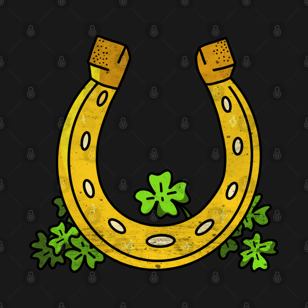 Lucky horseshoe and four leaf clovers