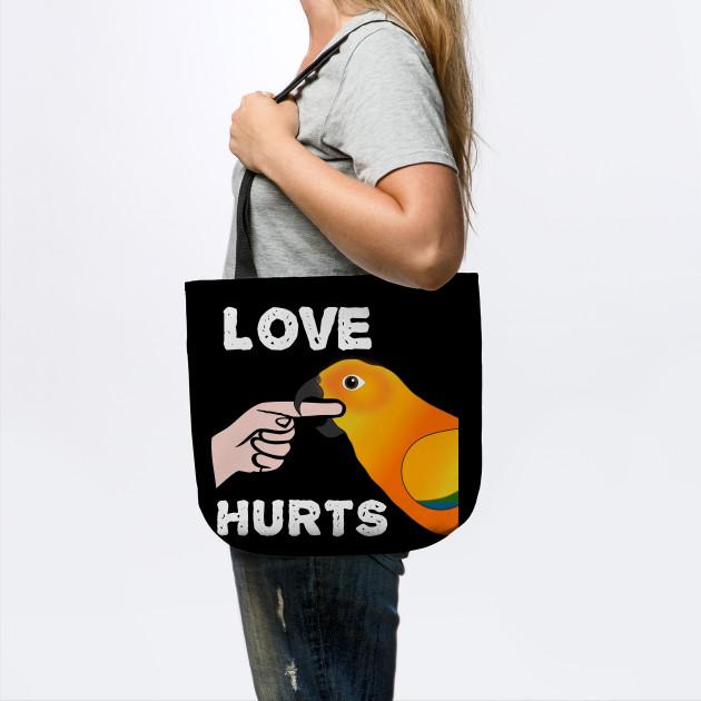 Love Hurts Sun Conure Parrot Biting