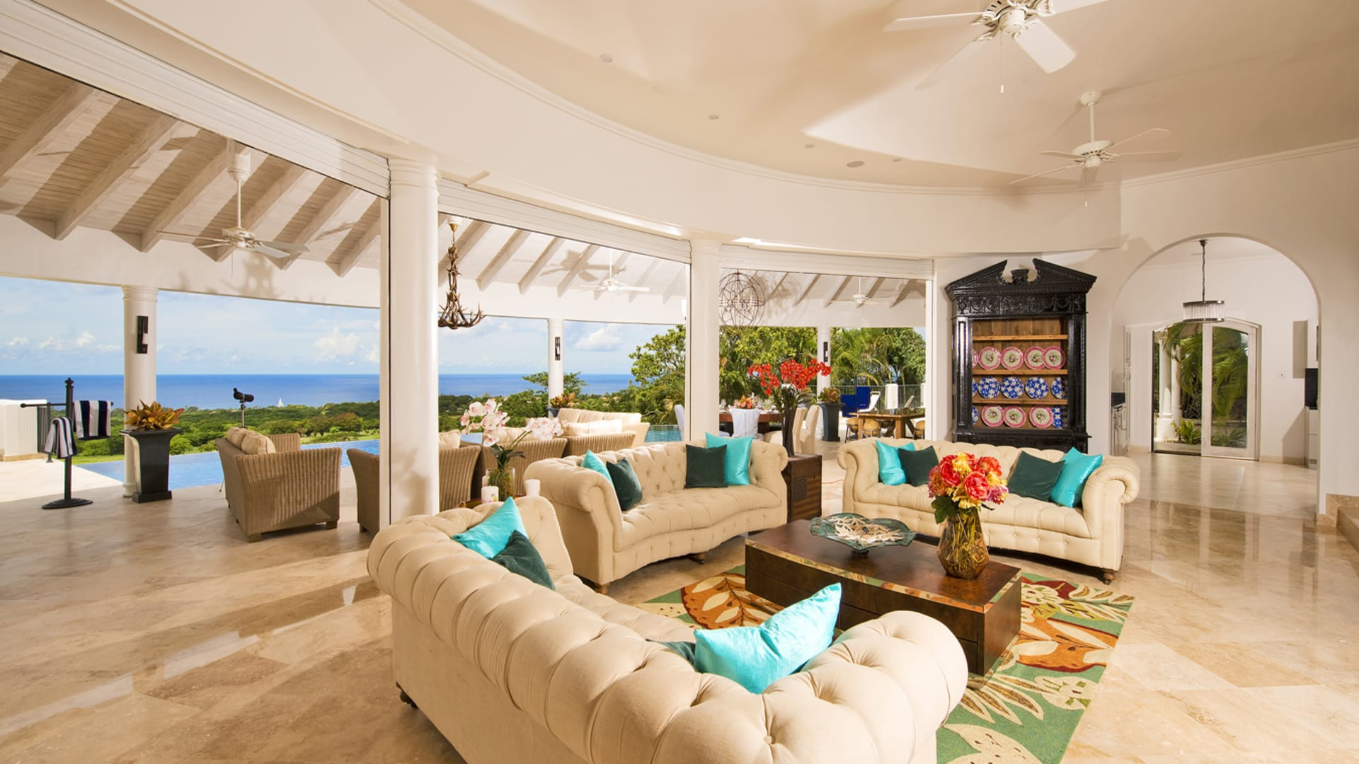 Main living area with opening to the outdoor pool terrace