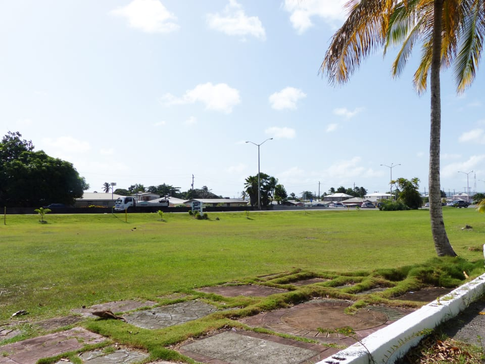 Lawn area to the front of the complex by the Highway