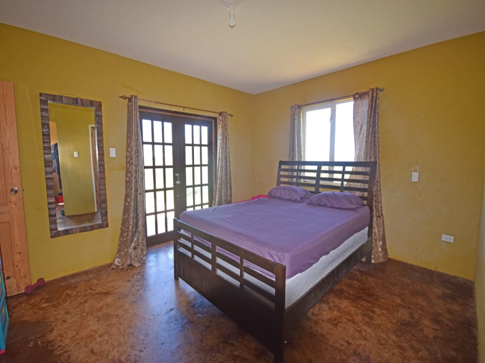 Master Bedroom with Doors to Terrace