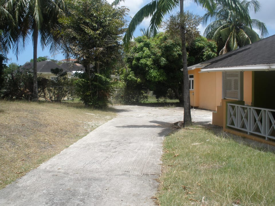 View of grounds and paved driveway