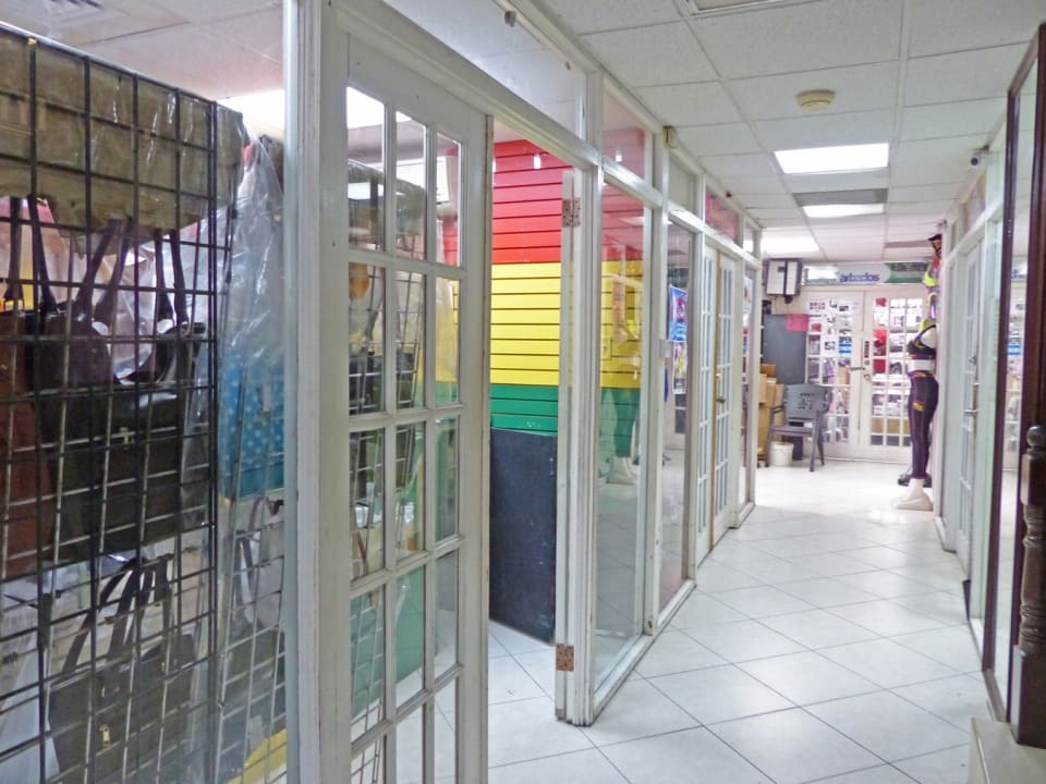 Corridor with shops on either side
