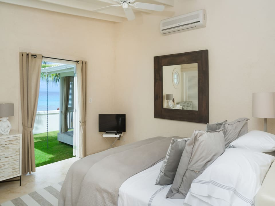 Master bedroom with french doors opening to garden