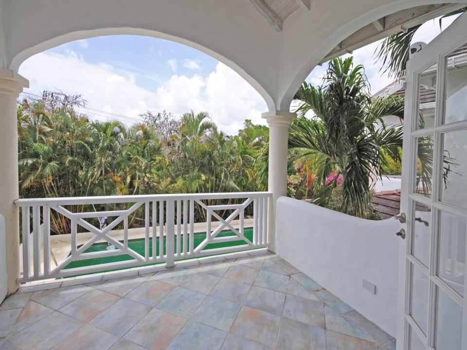 Master bedroom balcony has lovely pool views