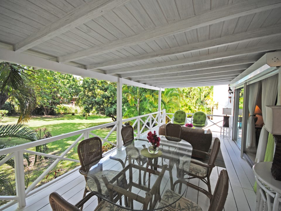 Elevated dining verandah has views of the lawns and gardens