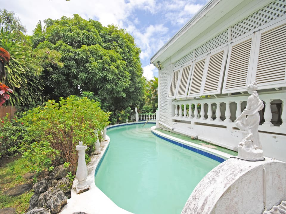 Terrace overlooks the wrap around swimming pool
