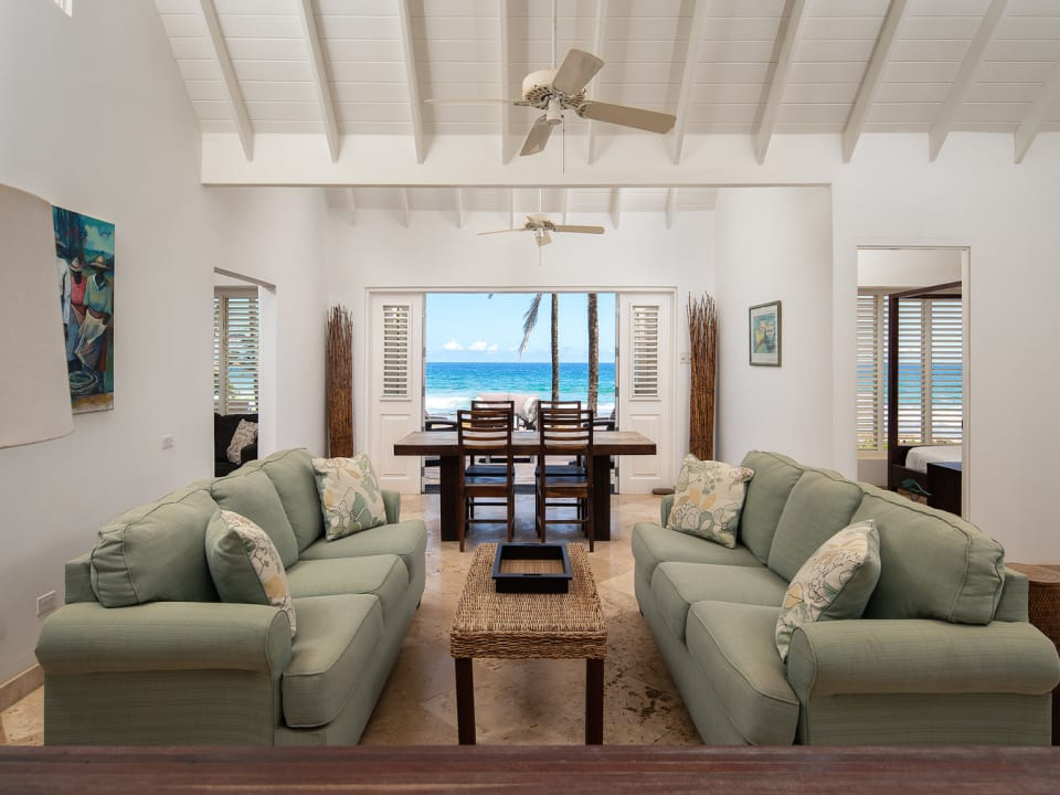 Living Room with High Ceilings and Views of the Sea
