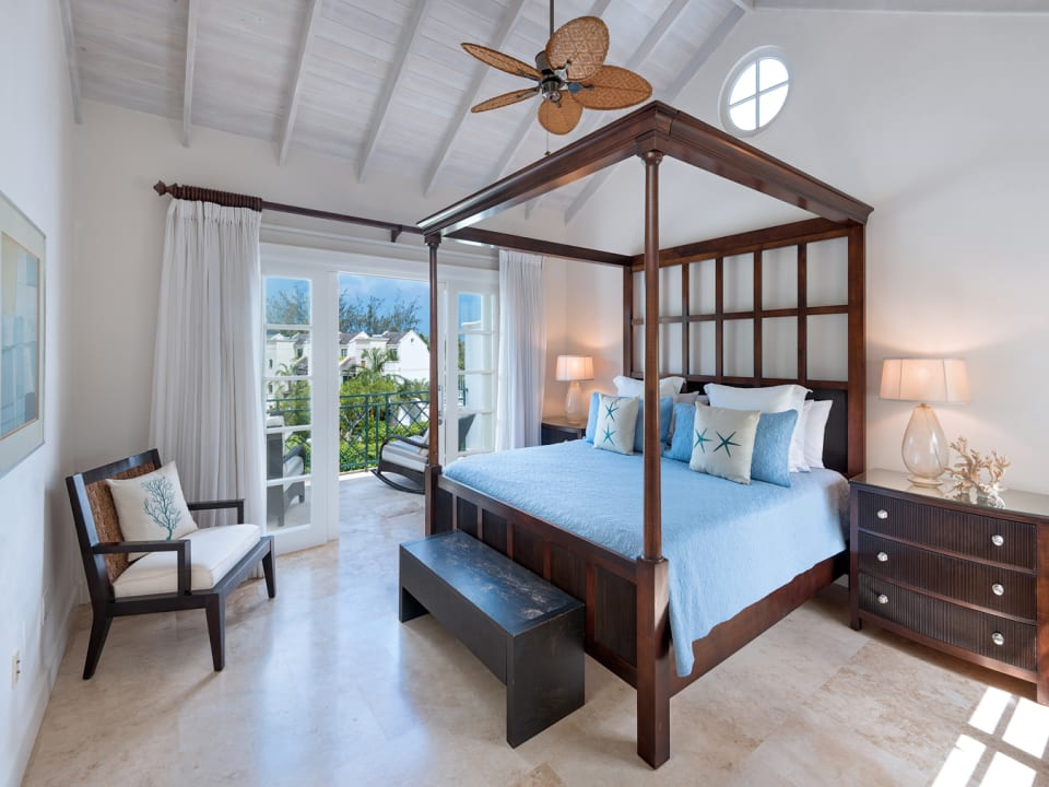 Master bedroom suite on 2nd floor has private balcony and sea views