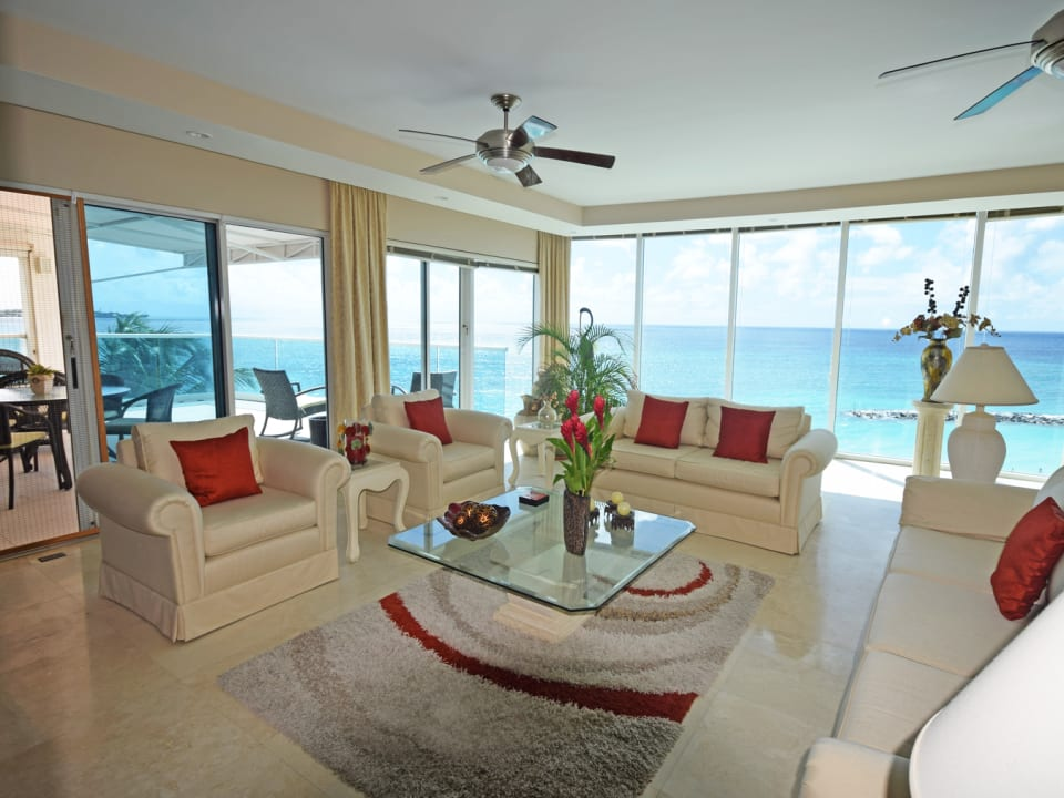 Living area with glass windows and views of the sea