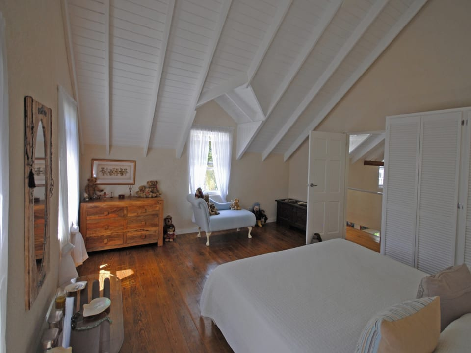 Master bedroom has wooden floors
