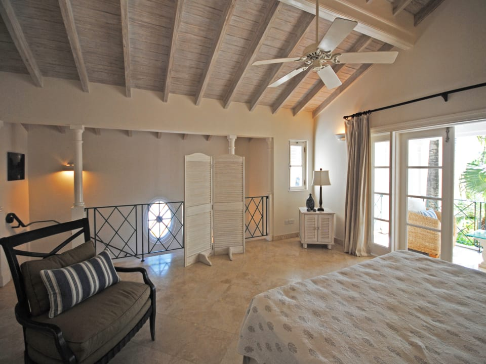 Master suite on first floor opens to a private balcony